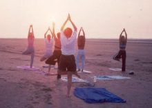 Yoga class from Prime Time Fitness, located in Sullivans Island SC cottage.