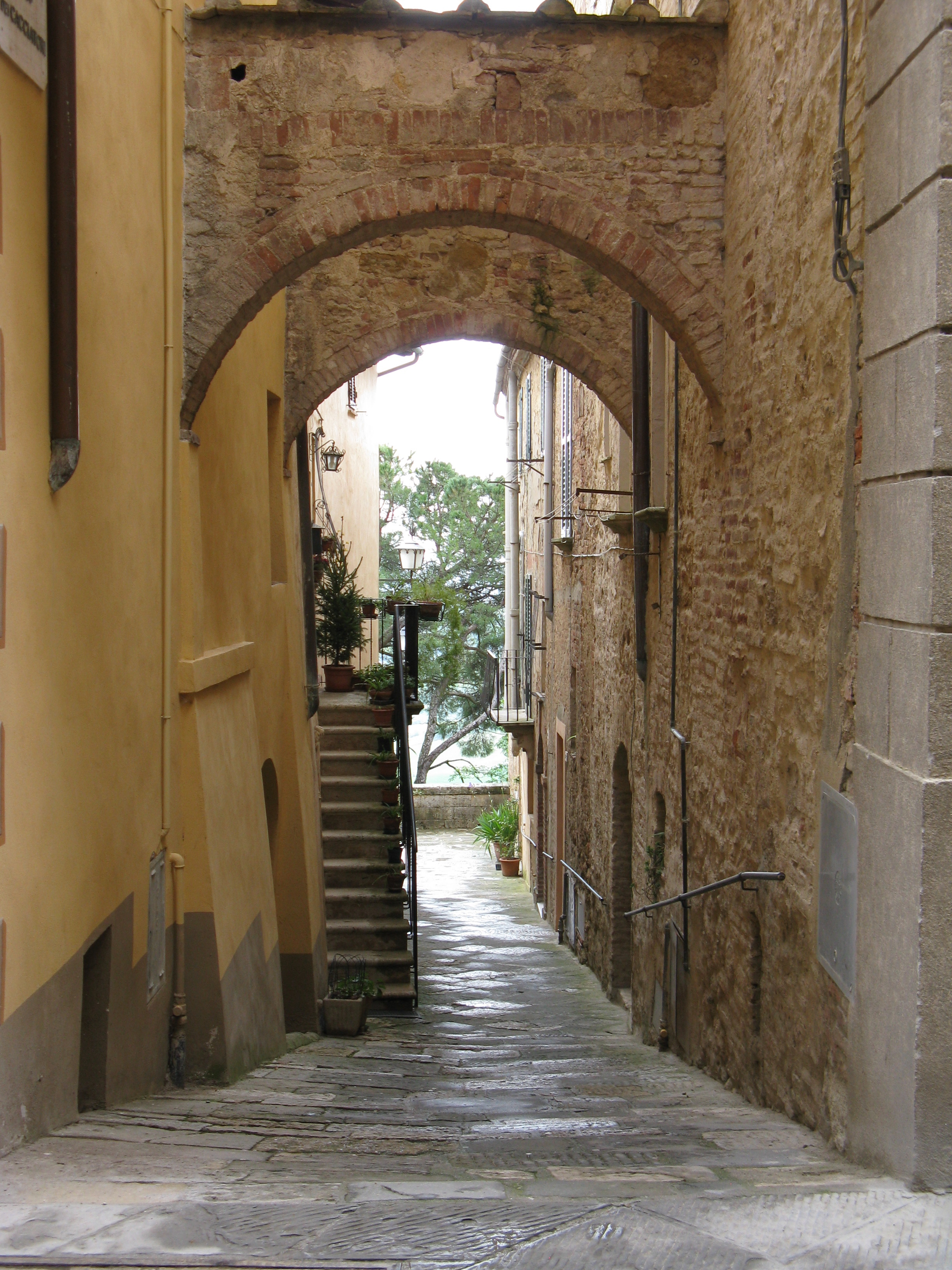 Exploring a narrow alley in Montepulciano